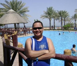 Eric Martin at Dubai Dreamland facing the Persian Gulf.